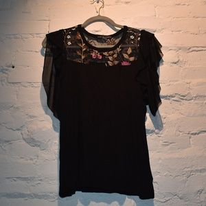 Adorable Black top with Sheer and Floral Neckline